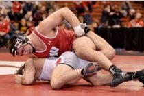 Badgers Claim First Ranked Conference Win